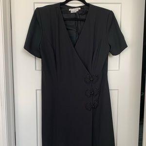 Midi dress by Maggy London. Wrap dress black